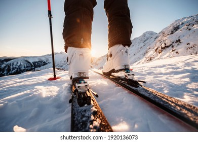 Mountaineer backcountry ski walking in the mountains. Ski touring in high alpine landscape. Adventure winter extreme sport. Detail boots.
