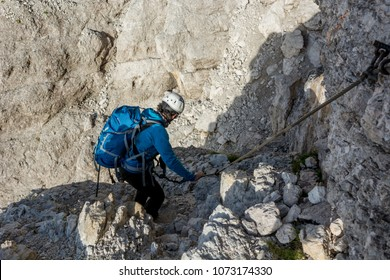 Mountaineer climbing in mouintains.