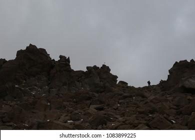 Mountaineer climbing Mount Savalan (Sabalan) mountain ridge in Iran. Savalan is the third highest mountain in Iran.