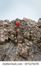mountaineer climbing a rock face