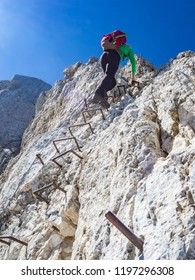 Mountaineer climbing the  vertical just below the top of the Prisojnik mountain in Julian Alps, Slovenia