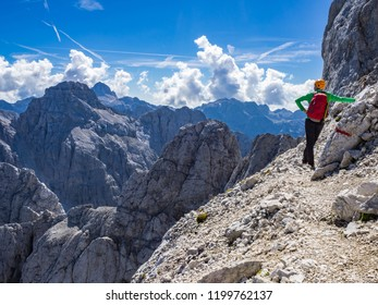 The mountaineer enjoying the view from the Prisank mountain in Julian Alps, Slovenia