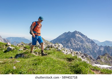 Mountaineer hiking in the alps