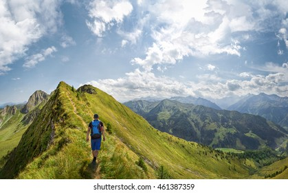Mountaineer hiking over a ridge in the alps, Austria