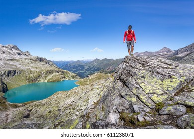Mountaineer hiking over a rock in the alps