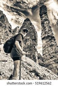 Mountaineer at peak of mountain enjoying natural landscape.