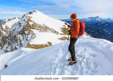 The mountaineer photographing with a mobile phone on the top of the ridge of the Begunjscica mountain, Slovenia