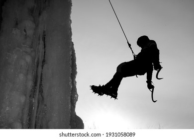 Mountaineer with rope and equipment
