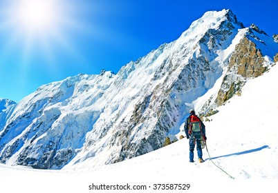 Mountaineer sport. A climber reaching the summit of the mountain