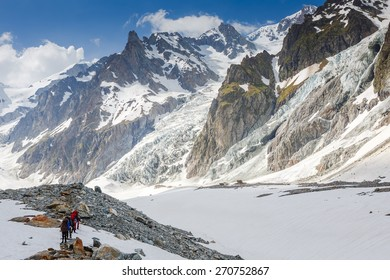 Mountaineer tourists hiking in Alps