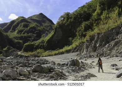 Mountaineer Trekking across Mount Pinatubo valley over lahar and pyroclastic flow remnants from its historic eruption in 1991