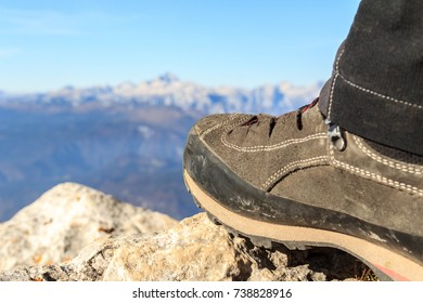 Mountaineering boot on top of a mountain