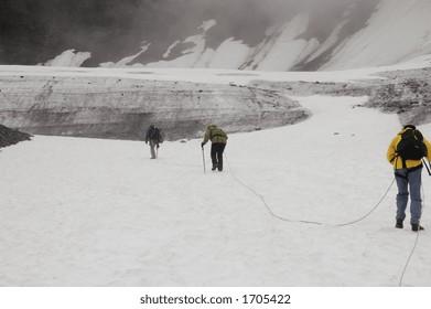 Mountaineers climb the Alyeska Glacier in Girdwood Valley, Alaska
