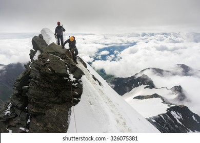 Mountaineers climbing Grossglockner, Austria, on the final snow ridge