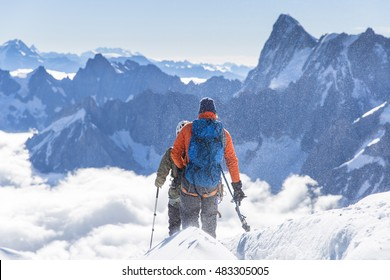 mountaineers go over the mountain in French Alps