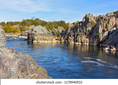 Mountainous banks of Potomac River on sunny day in autumn, Virginia, USA. A scenic river bend in Great Falls park, Virginia, USA.
