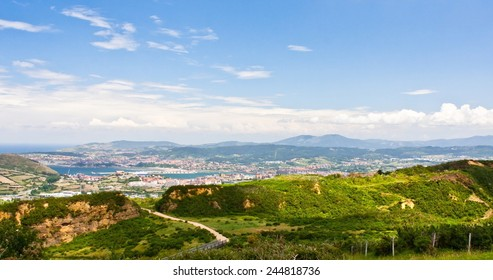 Mountainous landscape with city in the bottom on a cloudy day in the Basque Country