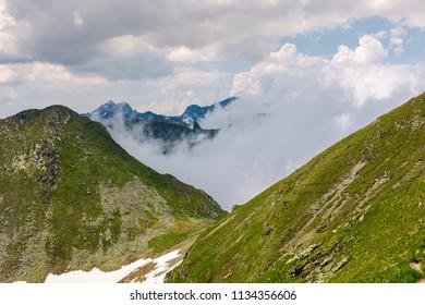 mountainous landscape on a cloudy summer day. beautiful nature scenery on high altitude. Capra peak, Fagaras mountains, Romania