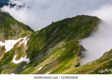 mountainous landscape on a cloudy summer day. beautiful nature scenery on high altitude. Fagaras mountains, Romania