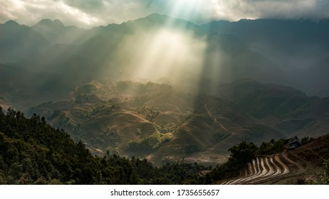 Mountainous Landscape With Sun Beams Breaking Through The Clouds, Near Sapa In Northern Vietnam