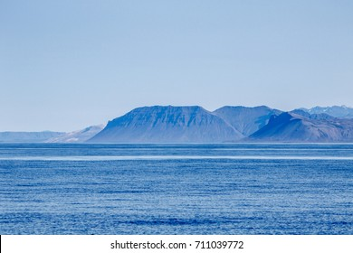 Mountainous landscape as viewed from ocean.