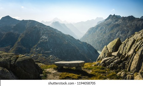 Mountainous panorma landscape view with big mountains. Mountain Pass in Switzerland. Autumn mood at sunset. Grimsel Pass links the Hasli Valley in the Bernese Oberland with Goms in Valais.