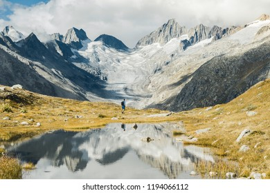 Mountainous panorma landscape view with big mountains. Mountain Pass in Switzerland. Autumn mood at Grimsel Pass. The pass road runs through a wild