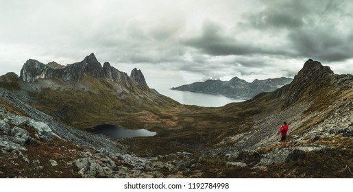 Mountainous panorma landscape view with huge fjords during cloudy sky in Senja, Norway