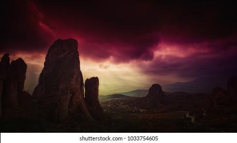 mountainous rocks under a violet overcast sky