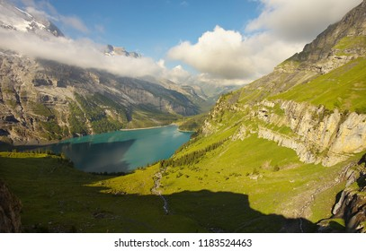 Mountains above the lake of Oeschinensee nearby resort of Kandersteg, Switzerland