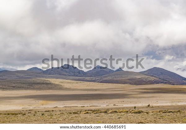 Mountains and arid climate landscape scene at Chimborazo National Park, Ecuador.