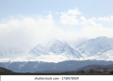 Mountains. Beautiful russian nature of Altai Krai, Russia. Forests and mountains with snowy peaks. Landscape, view, scenery, landmark of Altai Krai, Russia. Tourism, travel in Altai Krai. Altai hiking