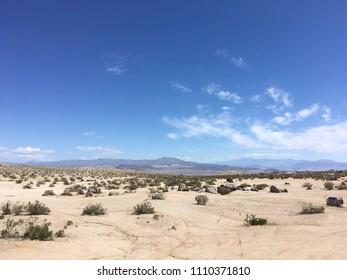 In the mountains of California in the summer. Stones, sand, sun