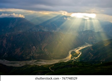 Mountains and Canyon, Chicamocha River in Colombia, Clouds and  Crepuscular rays