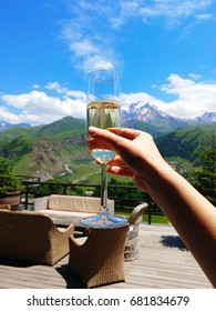 Mountains champagne hand