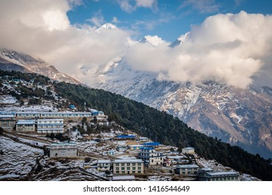 Mountains in the clouds behind village Namche Bazaar, Khumbu area, Nepal