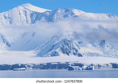 Mountains, clouds and icebergs in Antarctica