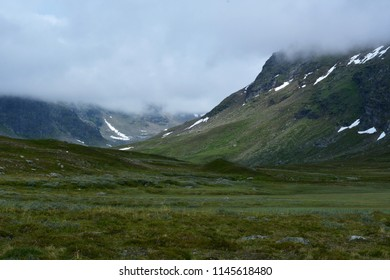 Mountains in the clouds. North Sweden mountains. Hemavan, kungsleden trail. One of the most beautiful trails in the world. Mountains with snow.