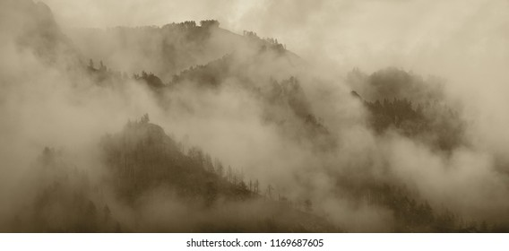 Mountains in the clouds, sepia landscape, natural backgrounds