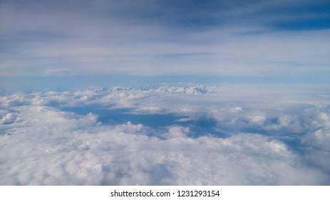 Mountains and clouds from the sky.
