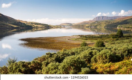 The mountains of Coigach and Rosshire rise from the shores of Loch Broom, an inlet of the Atlantic at Ullapool in the Northwest Highlands of Scotland.