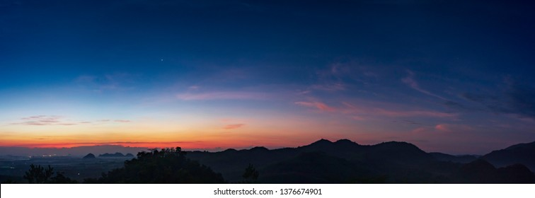 Mountains and colorful sky.