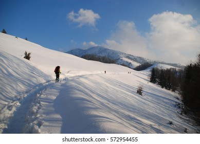 Mountains covered with fluffy snow against clear blue sky, Carpathians, Ukraine.