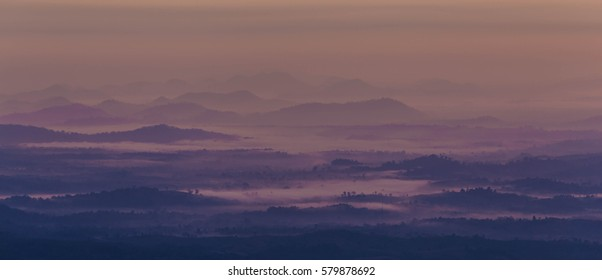 Mountains covered with fog in the morning