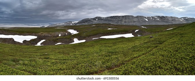 Mountains with dark dramatic sky in Northern Norway