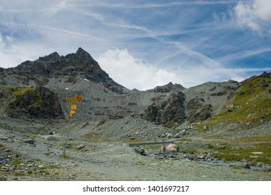 Mountains and direction sign to col de prafleuri and cabane de prafleuri a hiking path in Switzerland