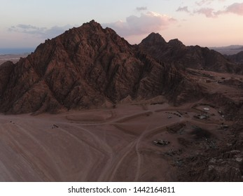 Mountains in Egypt, desert, quad bikes in distance