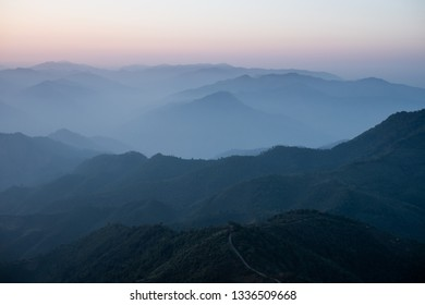 Mountains, fog and sunlight in the morning of the new day