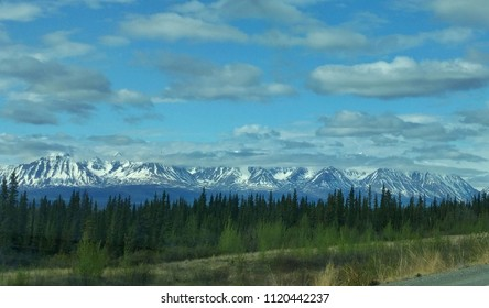 Mountains and forest under pretty cloudy sky on the Kenai peninsula, Alaska