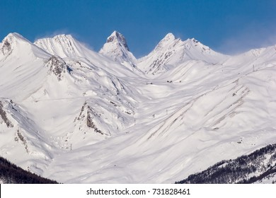 Mountains in the French Alps in winter sunny day. Avalanche zone.